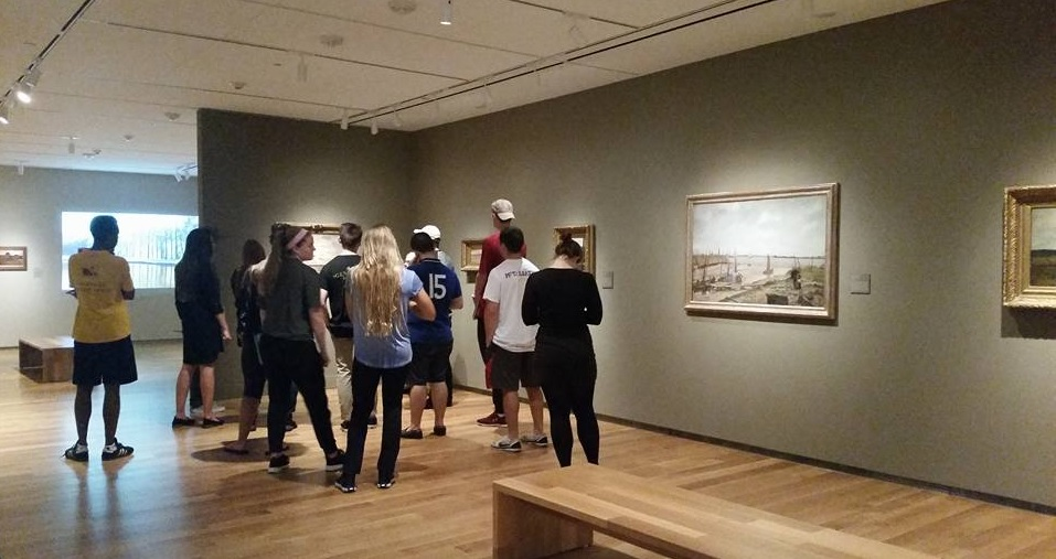 Students in the History core survey class Race & Religion in the Atlantic World visit an exhibition the McMullen Museum of Art on the Boston College campus
