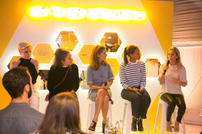 "Bumble CEO Whitney Wolfe Herd speaks on the ""Female Founders"" panel as Dr. Barbara Sturm, Lulu Kennedy, Cassandra Stavrou, and Alice Casely-Hayford look on."