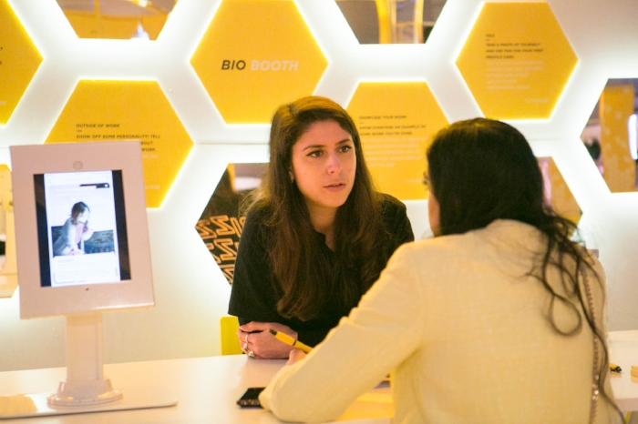 A user works with a Bumble staffer to build her BumbleBizz bio.