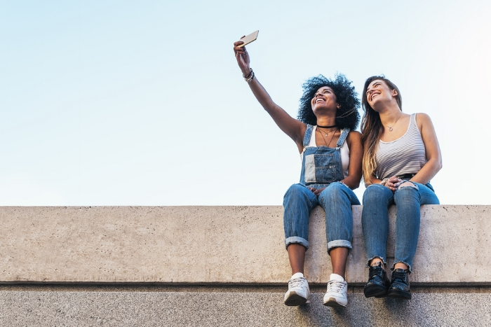 female friends hanging out taking selfie