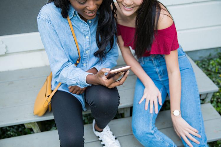 girls looking at phones.jpg