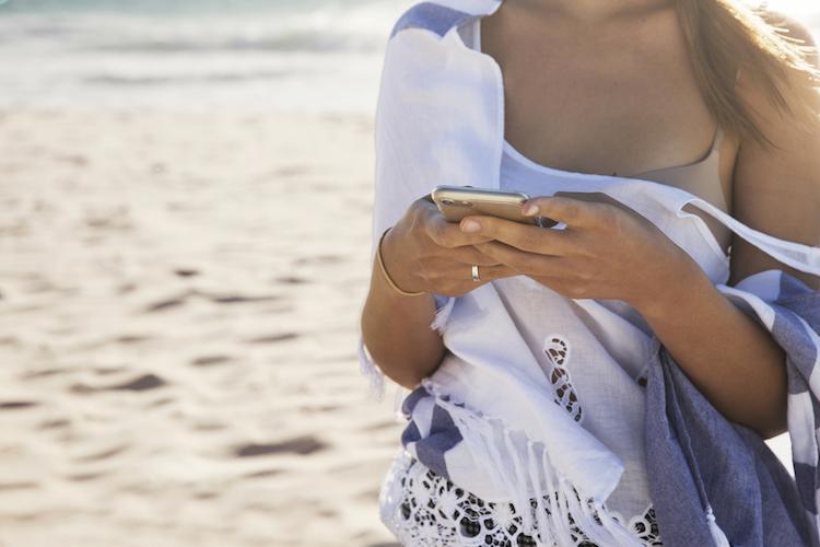 girl on beach phone aus.jpg