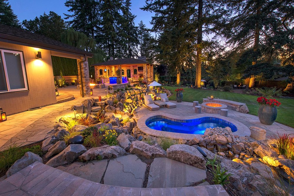 Outdoor entertainment area complete with pool, fire pit, and bar.