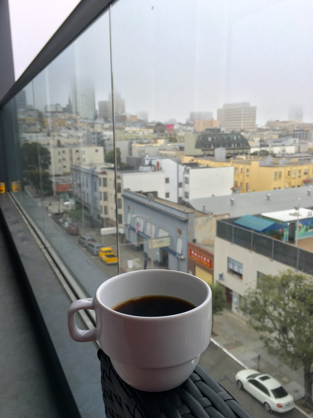 Enjoying a cup of Bleu on the balcony- the only thing keeping me warm on this foggy SF day