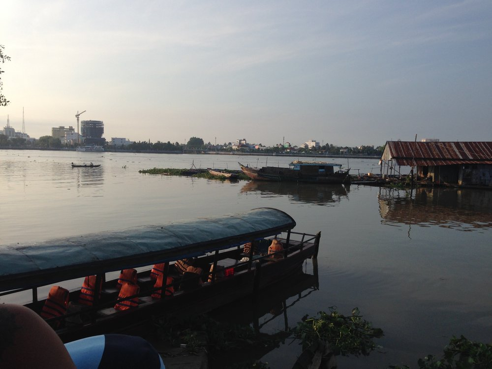 Sun rising over our boat, Mekong River Delta