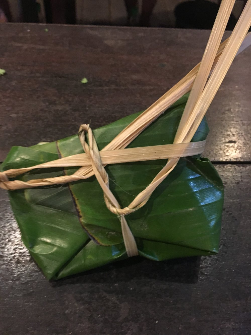 Wrapped banana leaf package ready for the steamer