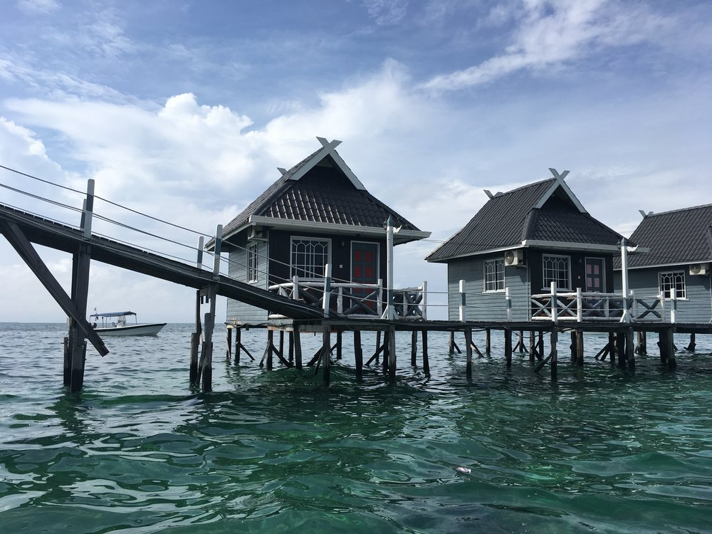 Bungalows with slanted walkway for boats to pass under
