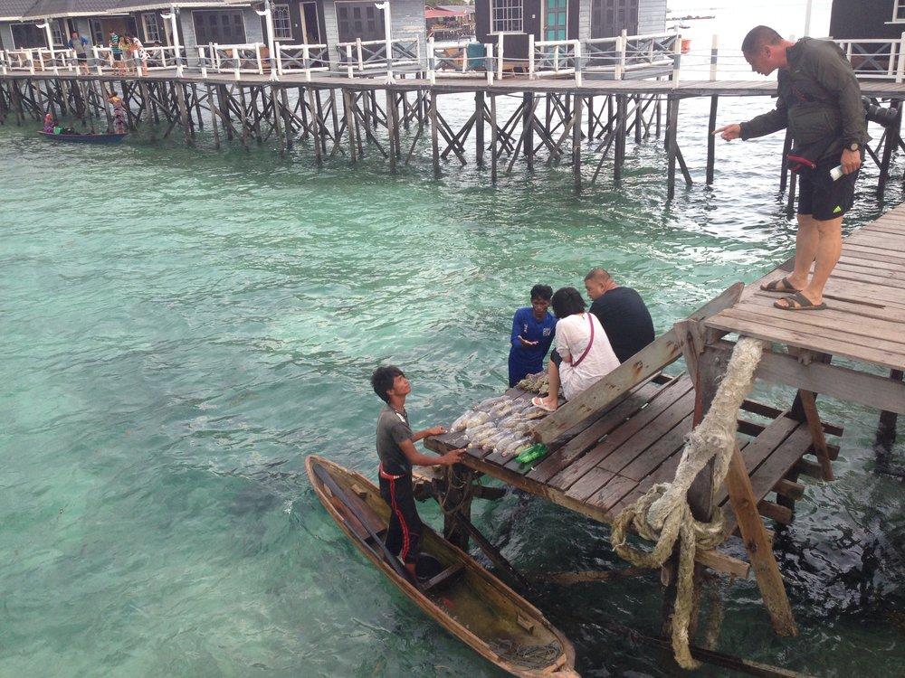 Sea gypsies selling fish at our resort