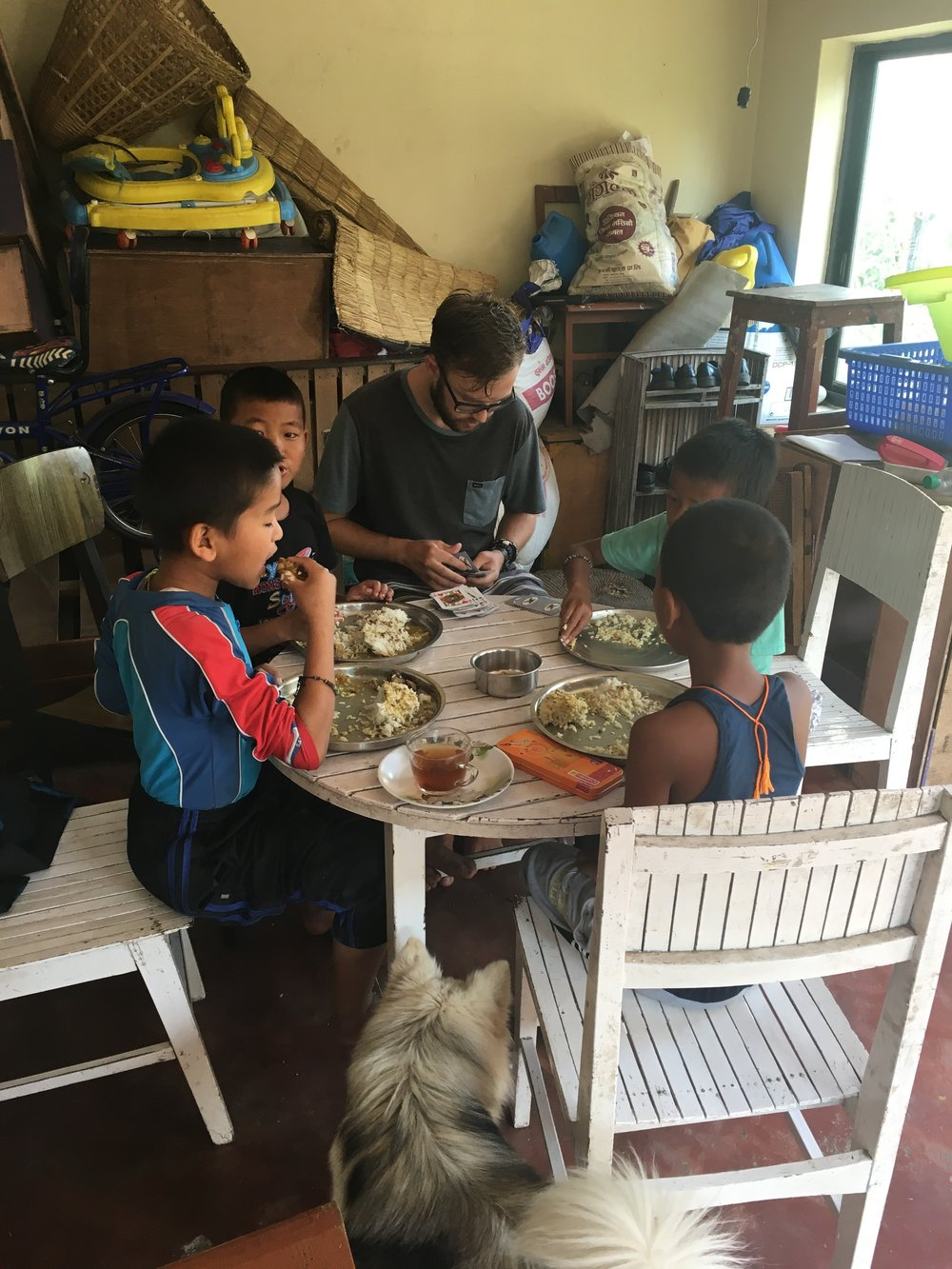 The boys breakfast on dal bhat before school