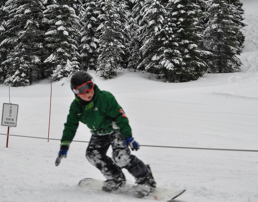 Level 5 - At level 5, students are beginning to link turns on more difficult 'Blue' or intermediate terrain such as 'Spotlight' and 'Wildfire.' Depending on a child's ability to confidently control their skis, more technical aspects of skiing are introduced such as transitioning out of the wedge and into a more parallel stance.