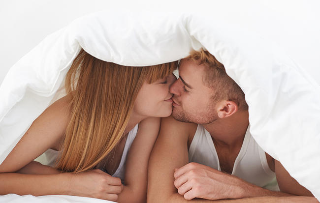 4-get-closer-in-bed-without-cuddling-kiss.jpg