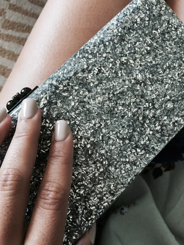 It's as if a vintage clutch from the 50's had a baby with a space unicorn, and they called it Flavia.