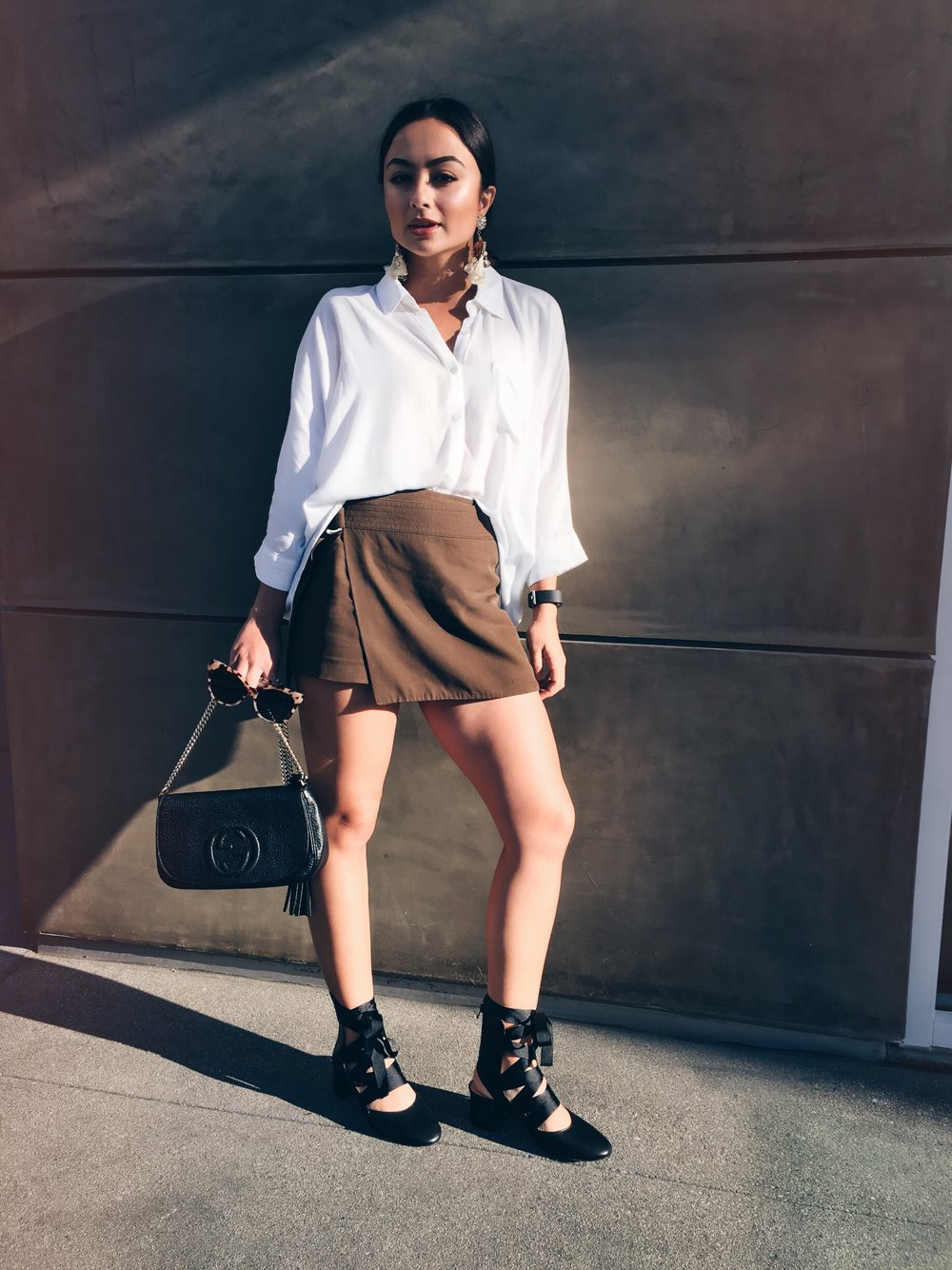 Shirt, skort, earrings H&M  Sunglasses Urban Outfitters  Bag Gucci  Shoes Zara