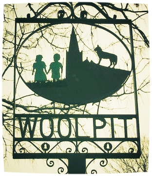 The sign of Woolpit village, where many believe the story has some basis in truth, via  Wikimedia Commons