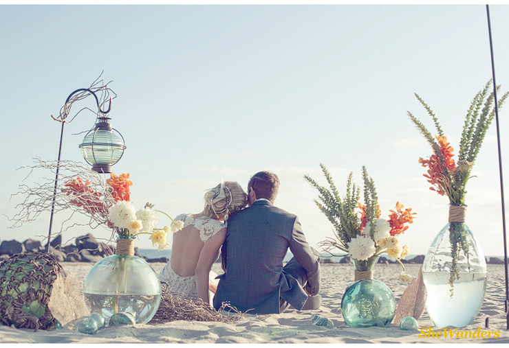Bride and Groom on beach, orange and white flowers in blue vases, San Diego Wedding Photography, Shewanders Wedding Photography