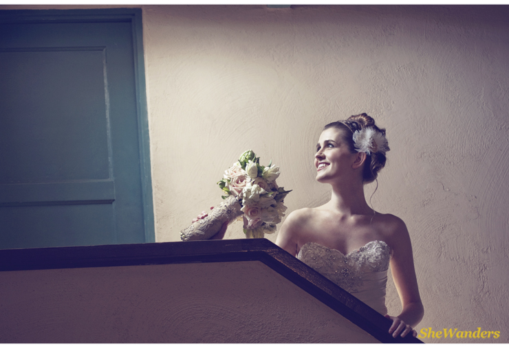 Bride on Stairs, white flowers, Shewanders Photography, San Diego Wedding Photography