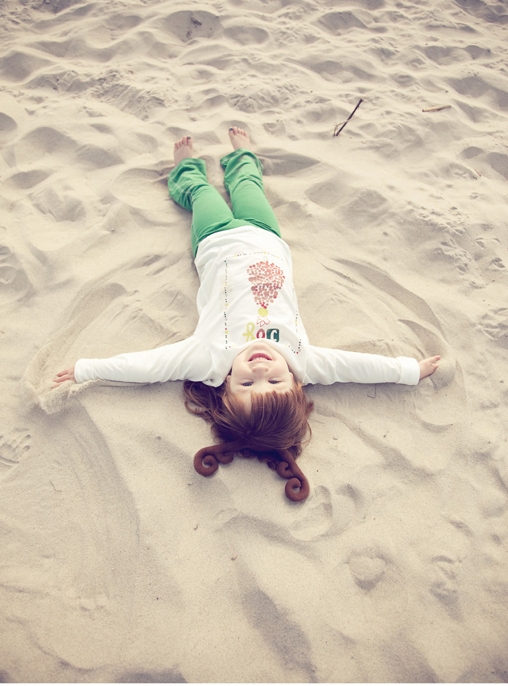 Abby lying on Sand in green pants, San Diego Wedding Photography, She Wanders Wedding Photography