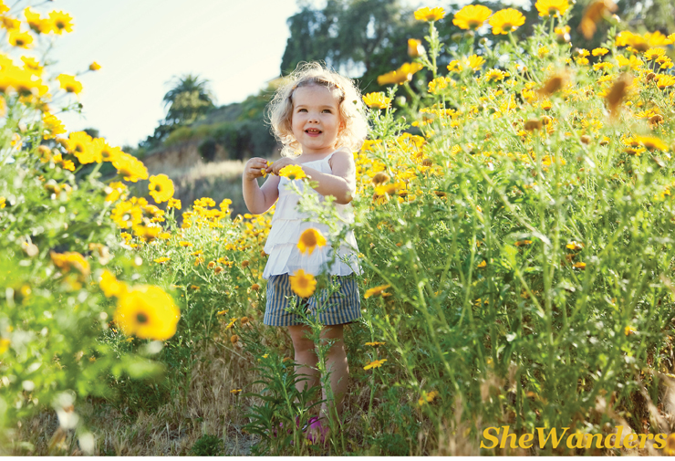 curly haired girl, in sunflowers, San Diego Wedding Photography, SheWanders Wedding Photography