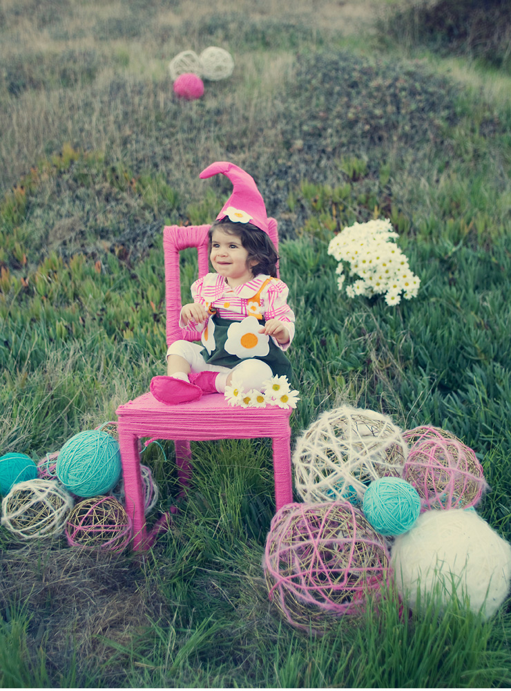 olivia, Sharons daughter in a hat surrounded by grass and woven balls, San Diego Wedding Photography, She Wanders Wedding Photography