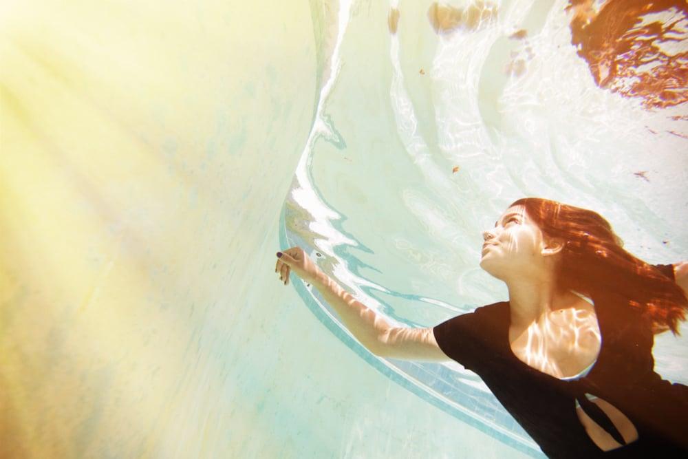 UnderwaterPhotographySwimmingSunshineAgainsttheWaterSanDiegoWeddingPhotographyShewandersPhotography.jpg