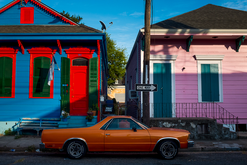 A car sits in the street of New Orleans.