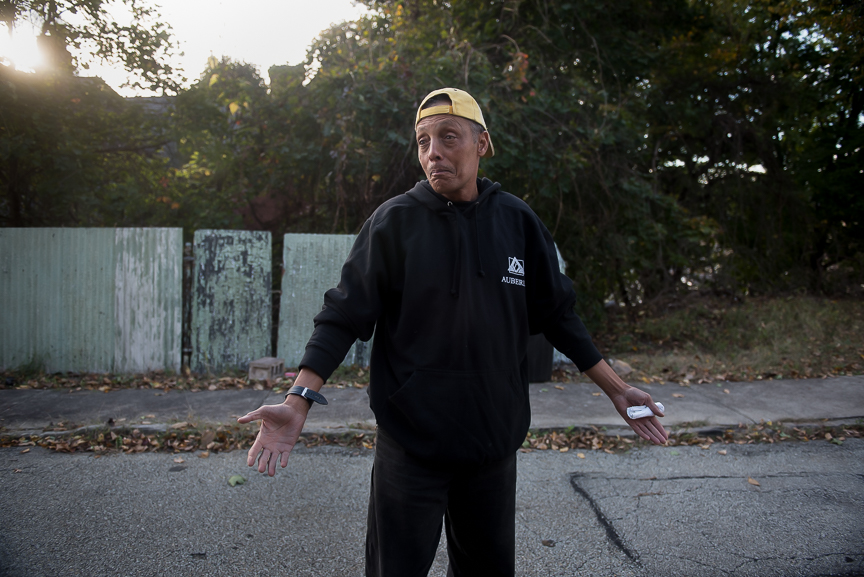 Harrold Nelson, 60, stands in the street in front of his home in McKeesport, Pa., on Oct. 25, 2016. Few homes remain on Nelson's block, many of those that do remain are abandoned.
