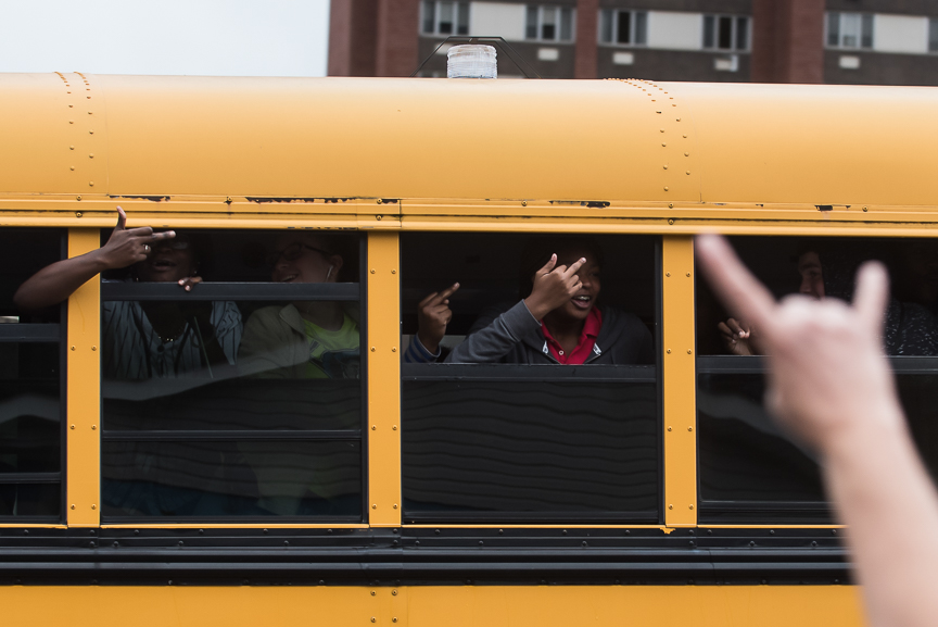 Students on a bus shout obscenities as they give the middle finger to Trump supporters lined up outside of the Cambria County War Memorial Arena prior to a Donald Trump campaign stop on October 21, 2016 in Johnstown, Pennsylvania.