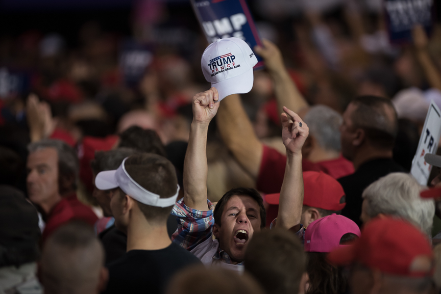 A Trump supporters yells at members of the media during Republican presidential nominee Donald Trump's campaign stop at the International Exposition Center on October 22, 2016 in Cleveland, Ohio.