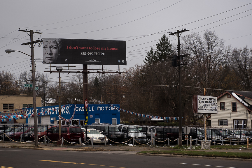 A billboard advertising protection for people losing their homes stands above a small car dealership in Youngstown, Ohio on Nov. 23, 2016.