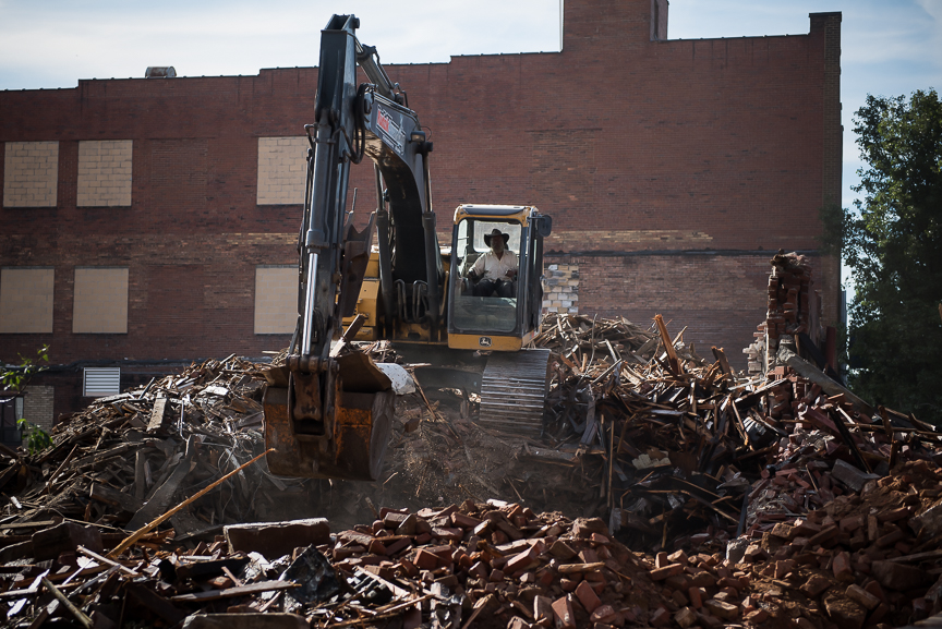 A crew works at a demolition site of a historic building in East Liverpool, Ohio on Sept. 15, 2016.