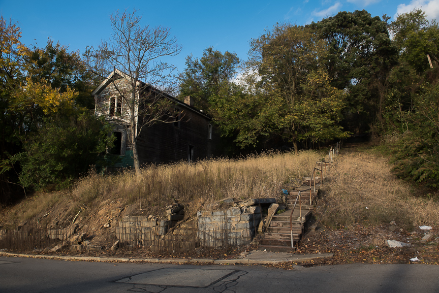 Steps lead to a vacant lot where a home once stood in McKeesport, Pa., on Oct. 25, 2016.