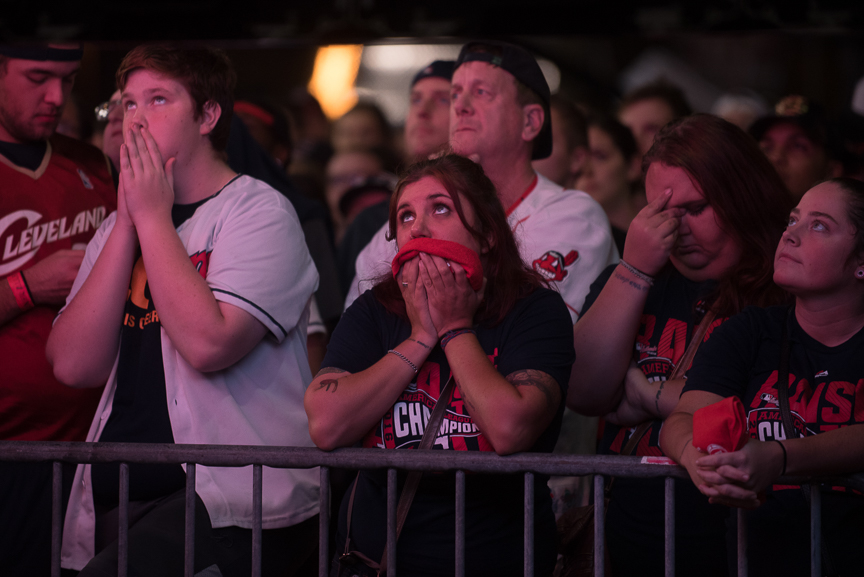 Fans react as they watch a big screen outside of Progressive Field during game 7 of the World Series between the Cleveland Indians and the Chicago Cubs on November 2, 2016 in Cleveland, Ohio. The Chicago Cubs defeated the Cleveland Indians 8-7.