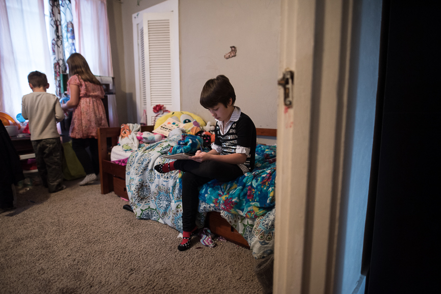 Sabrina Snyder, 9, draws as her brother, Miles, 5, and sister, Gabby, 10, look at their pet hamster at their Brookline home on Monday, January 30, 2017. Sabrina was mauled by a Rottweiler in Aug. 2014, leaving her with several physical injuries as well as emotional scars from the incident. Drawing is a favorite hobby of hers.