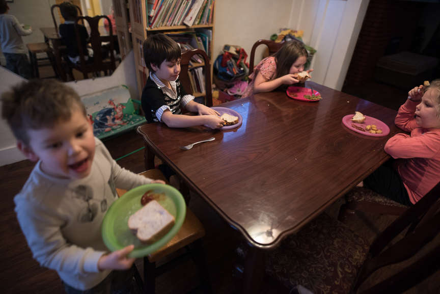 Sabrina Snyder, 9, second from left, sits at her dinner table with her siblings, from left, Miles, 5, Gabby, 10, and McKenzie, 5, at their Brookline home on Monday, January 30, 2017. Sabrina was mauled by a Rottweiler in Aug. 2014, leaving her with several physical injuries as well as emotional scars from the incident.