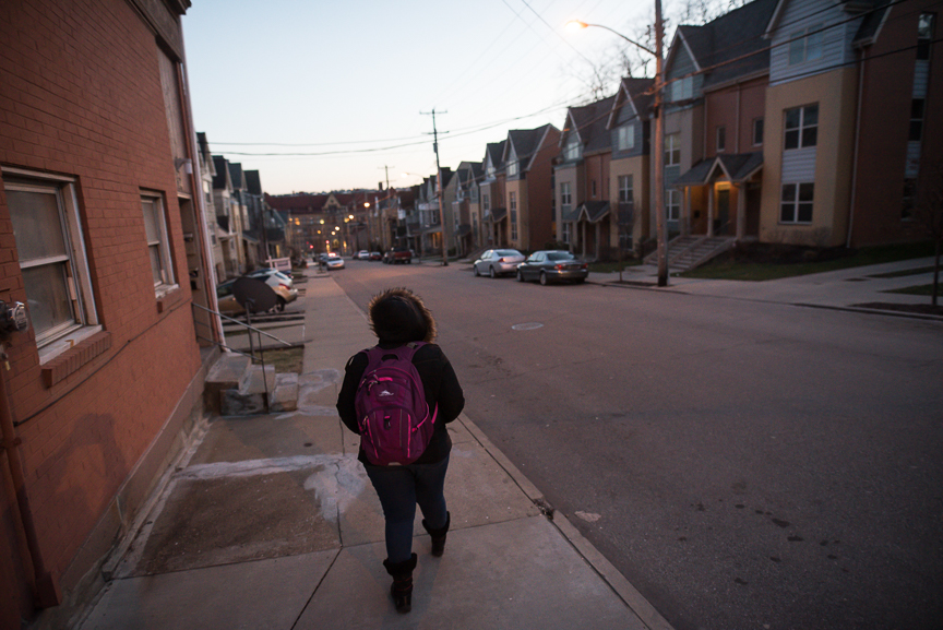 Monet Spencer, 18, walks home from her job tutoring at Pittsburgh Miller PreK-5 in Pittsburgh's Hill District on February 13, 2017.
