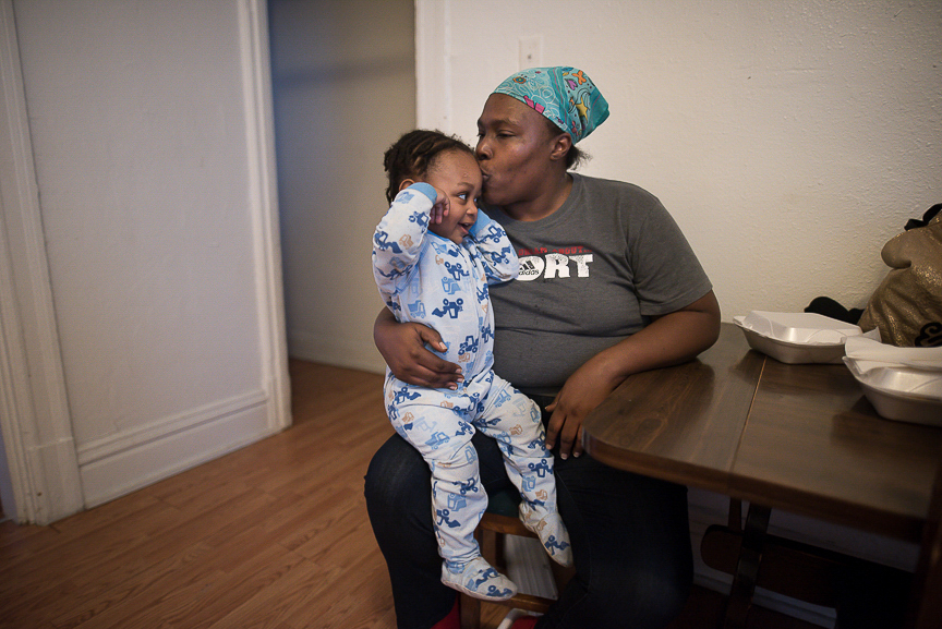 Ronnika Baker, 36, holds her grandson, Dorian, 2, in the dining room of their Braddock home on Feb. 28, 2017.