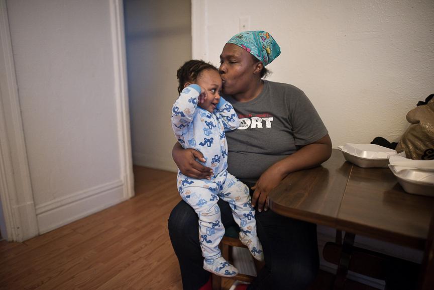 Ronnika Baker, 36, holds her grandson, Dorian, 2, in the dining room of their Braddock home on Feb. 28, 2017.