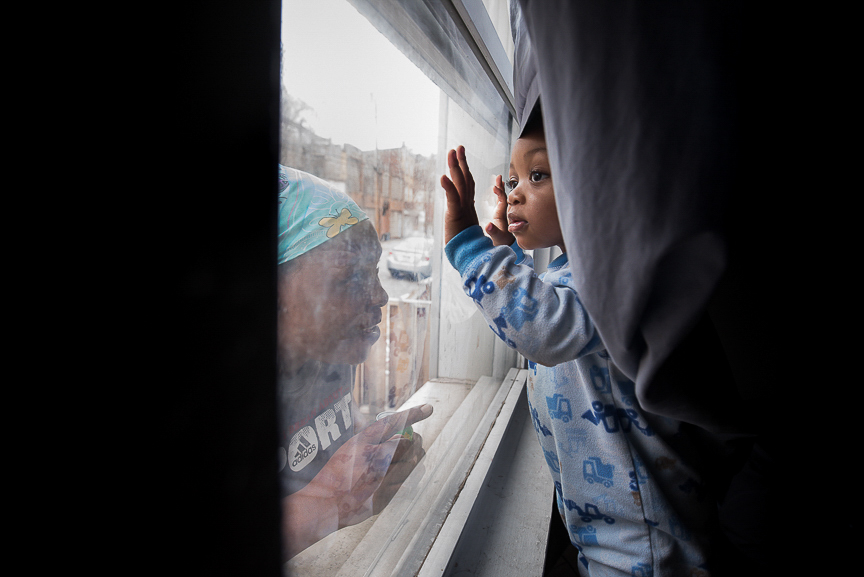 Dezmaire participates in the Allegheny Intermediate Unit's Project ELECT Program, which helps low-income pregnant teens and teen parents focus on education, training and employment goals. Here, her son, Dorian, looks out the window at his grandmother, Ronnika Baker, 36, at their Braddock home.