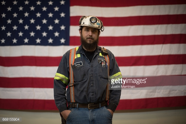 SYCAMORE, PA - APRIL 13: Donnie Claycomb, 27, of Limestone, West Virginia., who has been mining for 6 years, stands in front of an American flag prior to an event with U.S. Environmental Protection Agency Administrator Scott Pruitt at the Harvey Mine on April 13, 2017 in Sycamore, Pennsylvania. The Harvey Mine, owned by CNX Coal Resources, is part of the largest underground mining complex in the United States. (Photo by Justin Merriman/Getty Images)