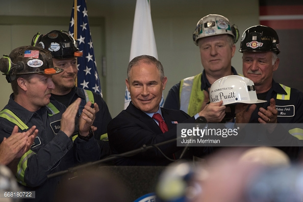 SYCAMORE, PA - APRIL 13: U.S. Environmental Protection Agency Administrator Scott Pruitt holds up a miner's helmet that he was given after speaking with coal miners at the Harvey Mine on April 13, 2017 in Sycamore, Pennsylvania. The Harvey Mine, owned by CNX Coal Resources, is part of the largest underground mining complex in the United States. (Photo by Justin Merriman/Getty Images)