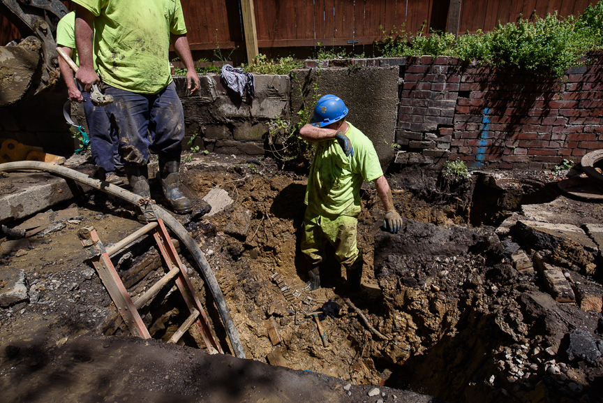 Pittsburgh Water and Sewage Authority's Brian Schacht wipes his face as he works to repair a broken lead public service line at a home on Wednesday, April 26, 2017 in Pittsburgh's Homewood neighborhood.  Justin Merriman  / for the Wall Street Journal