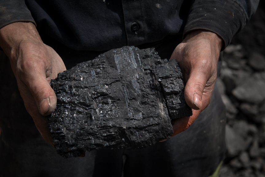 A coal miner holds a lump of metallurgical coal from the Middle Kittanning coal seam on May 18, 2017 in Friedens, Somerset, Pa.  Justin Merriman  for The Wall Street Journal