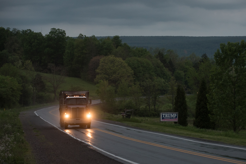 A coal truck drives past a Trump sign on May 19, 2017 on Million Dollar Highway in Jenner Township, Pa.  Justin Merriman for The Wall Street Journal