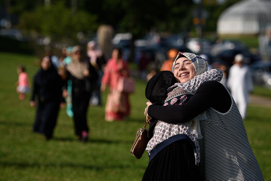 Aya Attal, 17, of Crafton, Pa., hugs a friend at an Eid al-Fitr celebration, marking the end of Ramadan, on June 25, 2017 in Pittsburgh, Pennsylvania. (Photo by Justin Merriman/Getty Images)