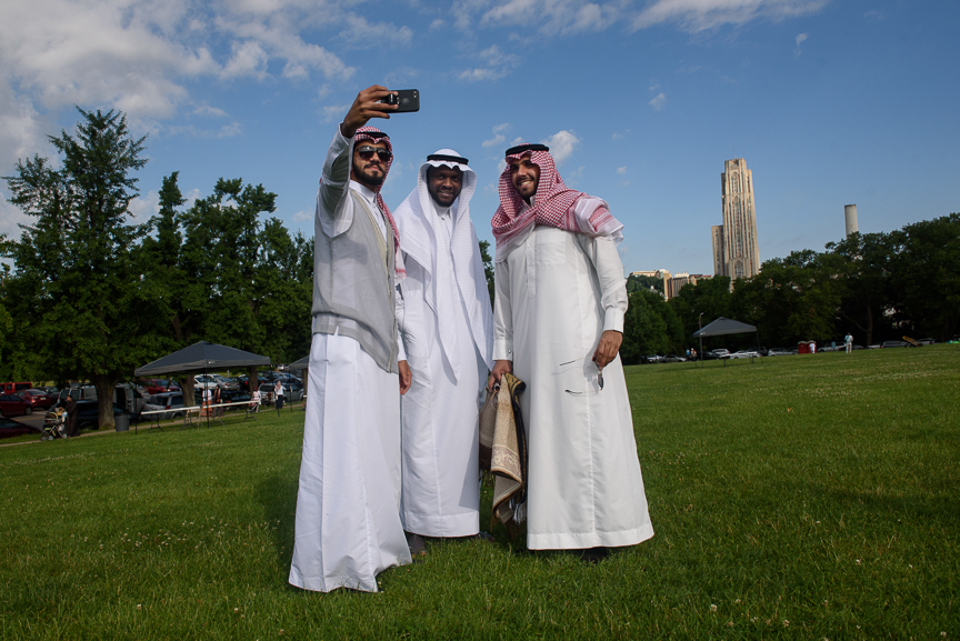 (left to right) Omar Sultan, 21, Majeed Hawsawi, 27, and Sultan Alsaykhan, 22, take a selfie together as they join hundreds of Pittsburgh muslims to celebrate Eid al-Fitr, marking the end of Ramadan, on June 25, 2017 in Pittsburgh, Pennsylvania. (Photo by Justin Merriman/Getty Images)