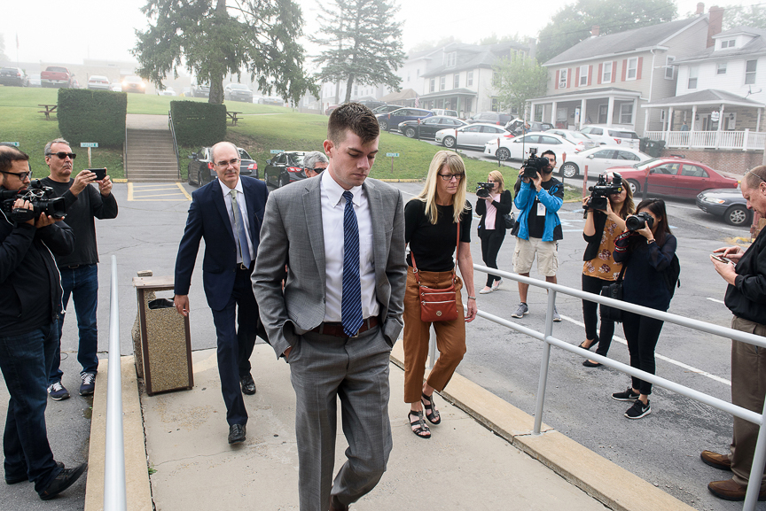 Brendan Young, president of the Beta Theta Pi fraternity, arrives back at the Centre County courthouse for the continuation of the preliminary hearing in the death of Timothy Piazza, 19, who died following a Feb. 2 pledge event at the frat house at Penn State University, on Thursday, Aug. 10, 2017 in Bellefonte, Pa.   Young faces 200 counts including involuntary manslaughter, aggravated assault, simple assault, tampering with evidence, recklessly endangering another person, hazing, furnishing alcohol to minors, and unlawful acts relative to liquor.