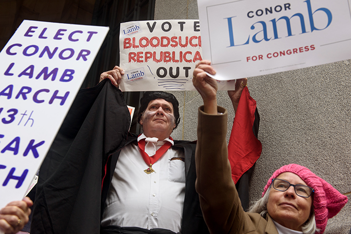 "Conor Lamb supporter Fred Bender, center, 70, of Peters Township, holds a sign saying, ""Vote Bloodsucking Republicans Out,"" as he joins in The Women's March on Washington - Pittsburgh ""Power to the Polls"" in Market Square on Sunday afternoon, January 21, 2017 in downtown Pittsburgh. Thousands came to Pittsburgh to join women's marches across the country this weekend."