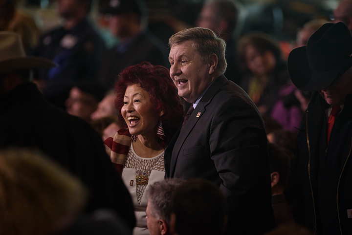 Republican nominee for congress Rick Saccone and his wife, Yong, talk with guests prior to the arrival of President Donald Trump for an official visit at H&K Equipment, a rental and sales company for specialized material handling solutions in North Fayette Township, Pennsylvania, on January 18, 2018. Trump visited the facility to talk about the Republican tax reform policy that was passed in late December and endorsed Saccone in his race against Democratic nominee Conor Lamb.