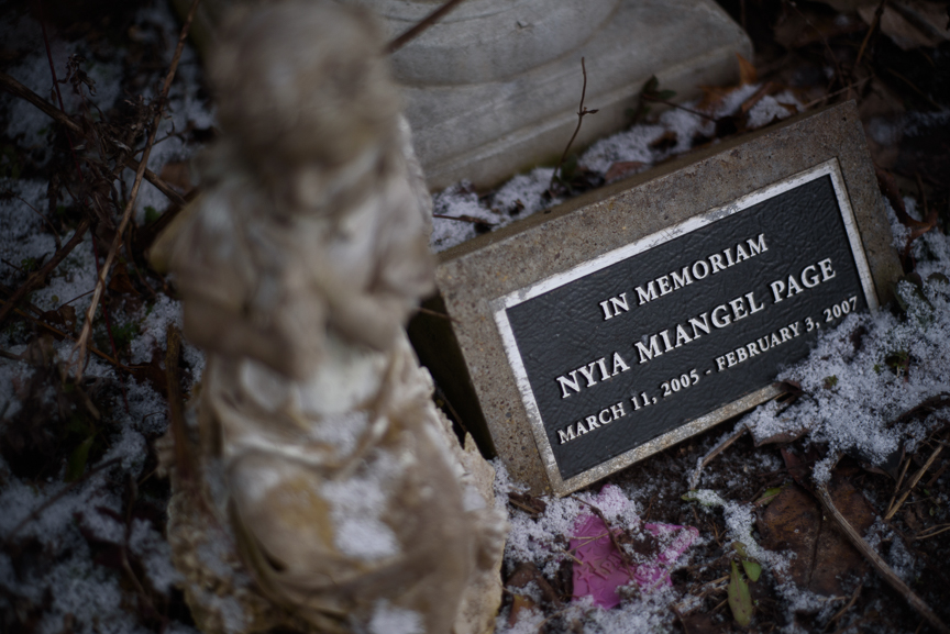 A memorial for Nyia Page is dusted with freshly fallen snow on Jan. 25, 2018, in Rankin, Pa.