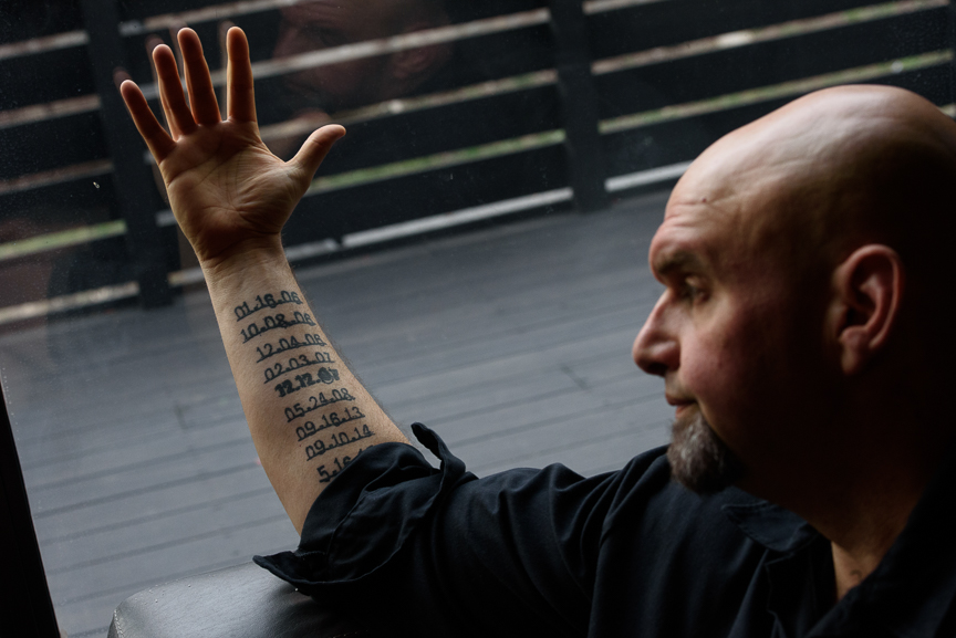 Braddock Mayor John Fetterman shows tattoos on his arm for every homicide in Braddock including Nyia's death on Feb. 3, 2007. He considers her murder the worst day of his time in office as mayor.